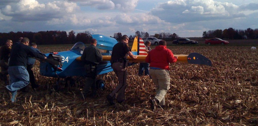 Alan Harder's FlutterBug getting pushed out of the corn stubble after a perfect precatuionary landing.