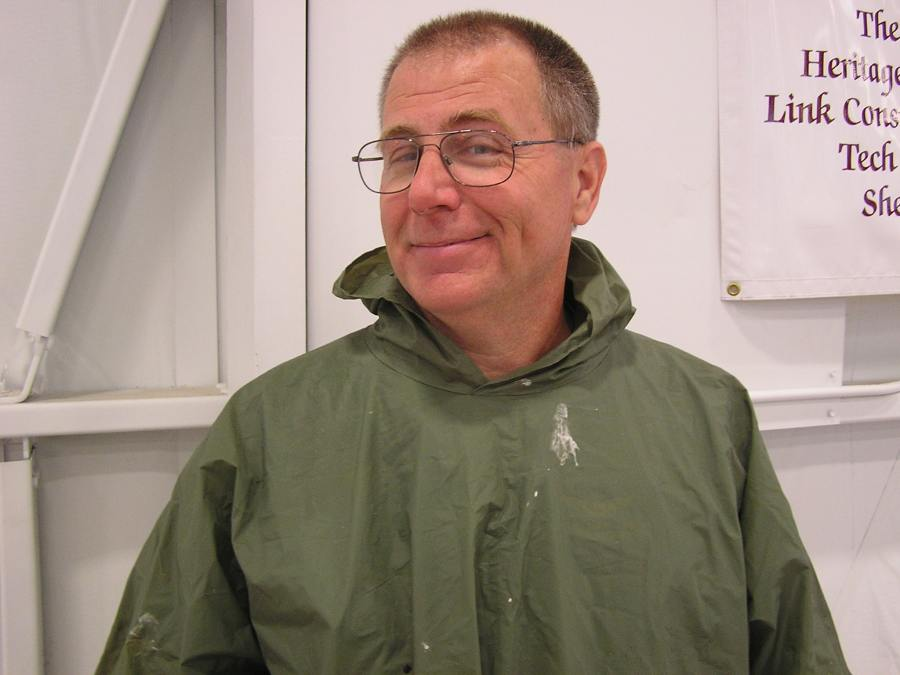 Matt In Poncho outside the Champaign Aviation Museum after the rains stopped